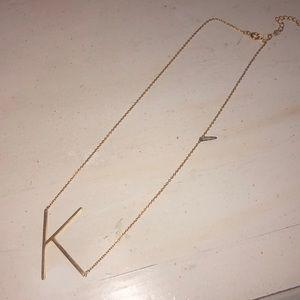 Anthropologie gold k necklace